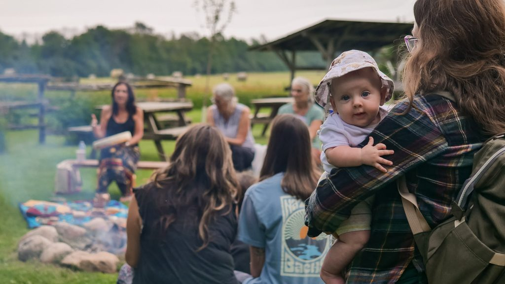 Herb Camp Gathering Baby in Arms